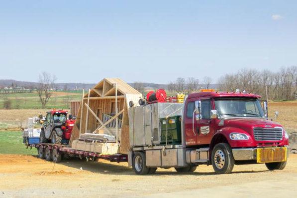 truck delivering prefab garage 0