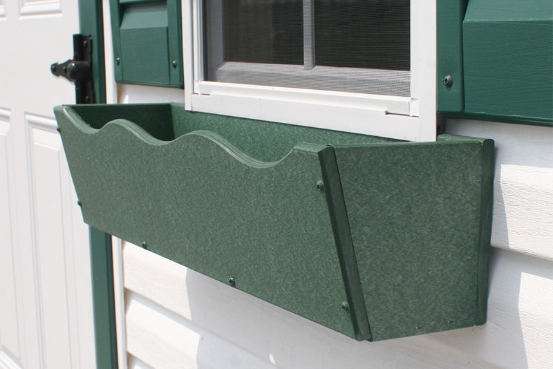green flowerbox garage window