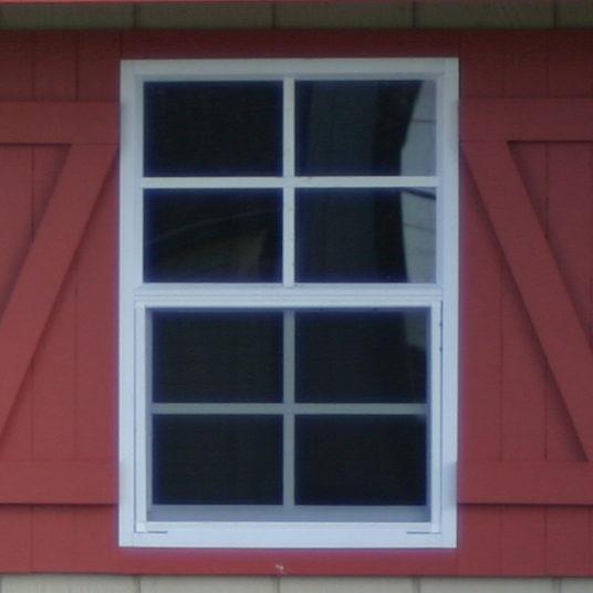 red shutters on custom garage