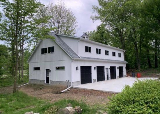 two story four car garage ohio white