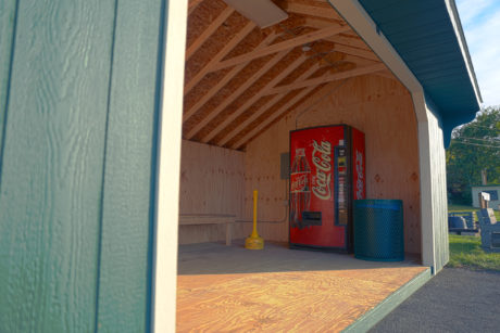 wooden saltbox soda machine shed