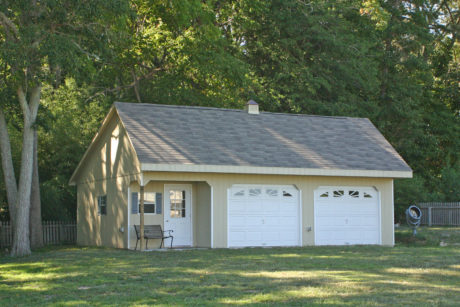 two car garage with unique porch