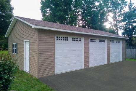 24x38 multiple car workshop garage with vinyl siding