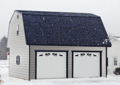 two story car garage pa with gray clapboard siding