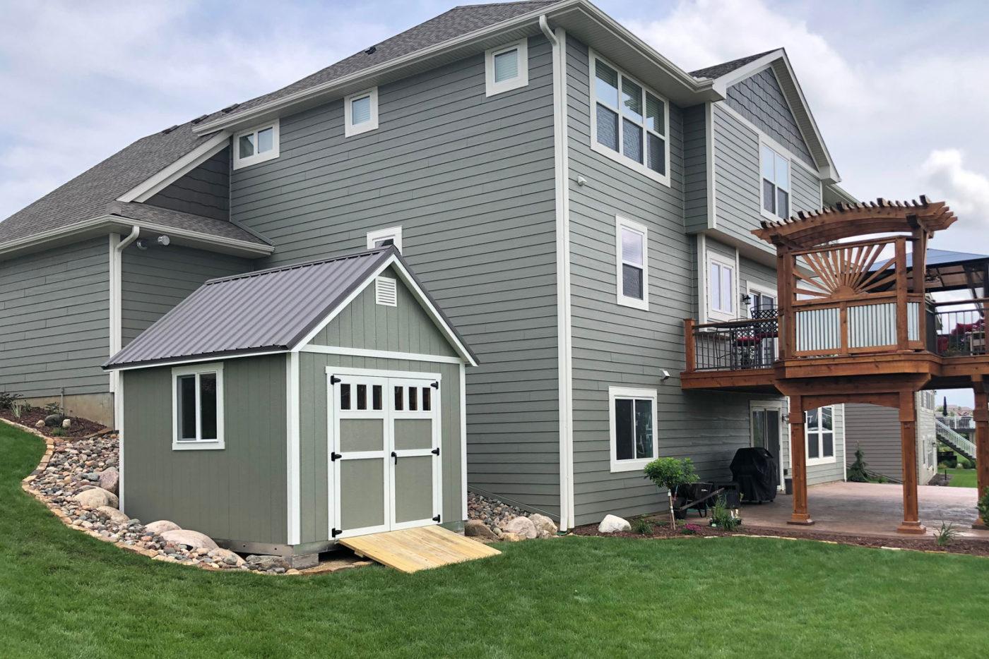 backyard storage sheds to match home