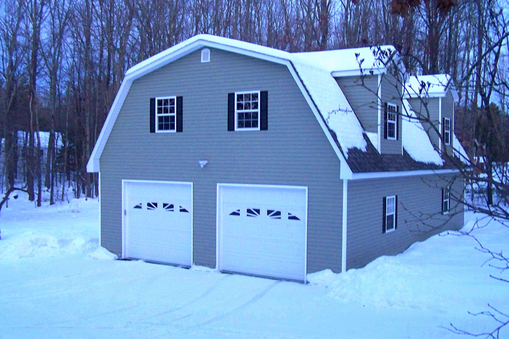 2 car garage with lift in snow