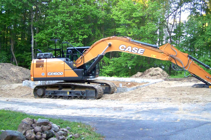 excavator for 2 car garage with lift
