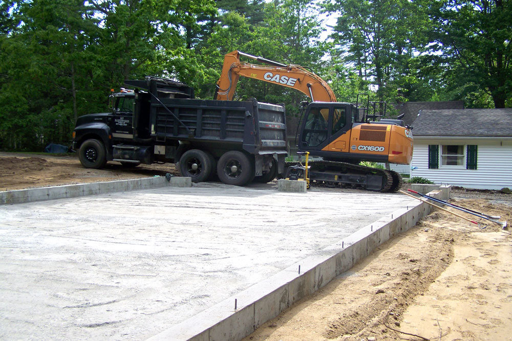 excavator with 2 car garage with lift foundation